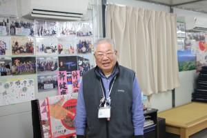 「あおい地区まちづくり整備協議会」会長の小野竹一(たけいち)さん。仮設住宅の自治会長も務め、地域全体を盛り立てている。